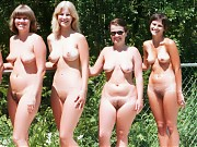 Many nudist people with different age