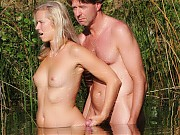 With a hungry eagerness lovers of sex at nature have sexual fun on a hot sand