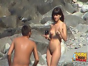 Horny guy takes his girl to the nudist beach